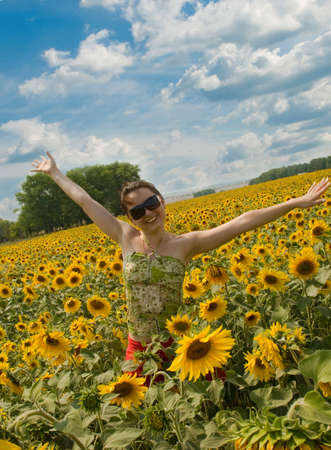 the girl running in the field of sunflower