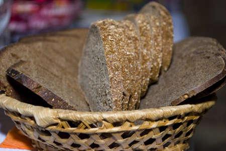 Photo of rye bread lying in a straw basket