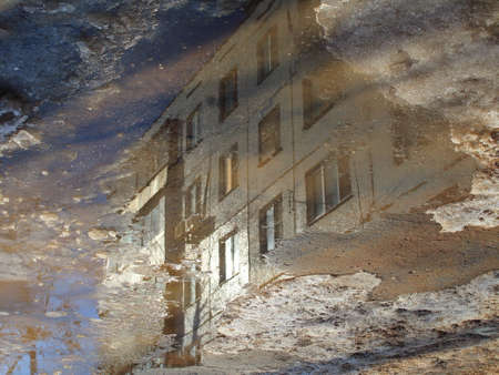 Reflection of a building in a puddle Standard-Bild