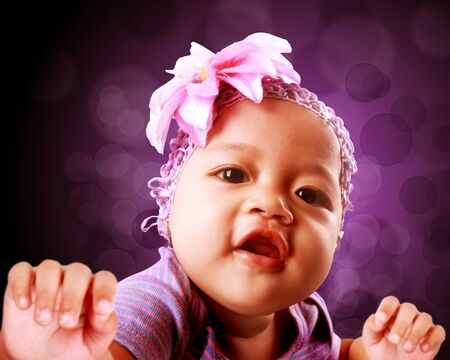 cute baby smiling  With copy space and bokeh background photo