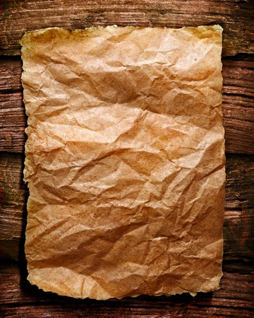 old papers on brown wood texture with natural patterns photo