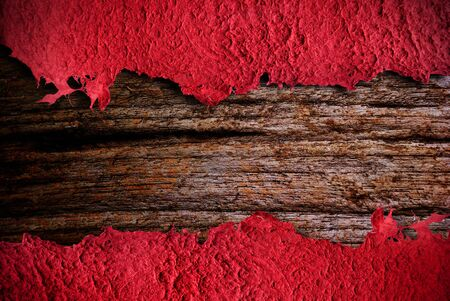 deckled: A red, vintage paper background with wooden background Stock Photo