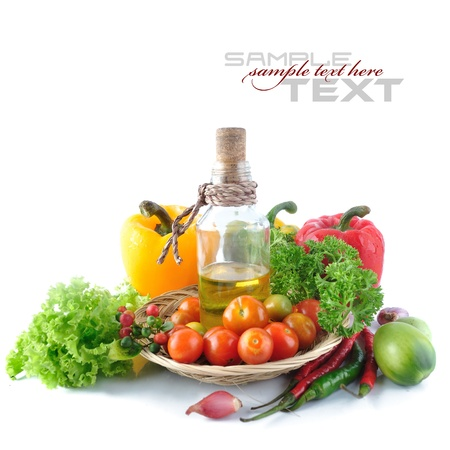 tomatos: Tomatos, paprika, garlic, red chili, olive oil and parsley on white background (with sample text) Stock Photo