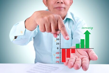 man show a increasing goal with increasing graph photo