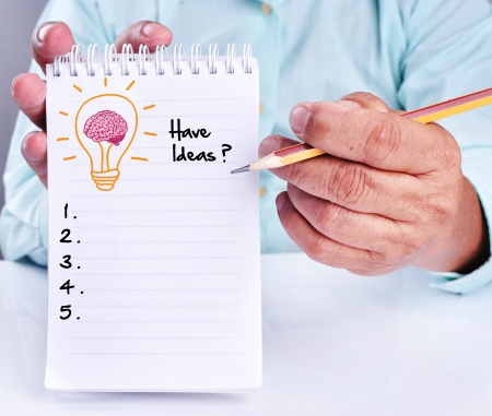 brilliant idea: business hand writing idea or innovation list on notepad. With lamp of brain icon