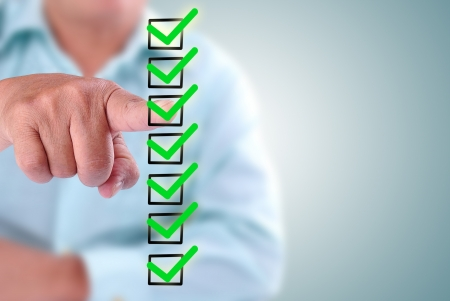 business man designed on a checklist box. With green checklist Stock Photo - 16588848