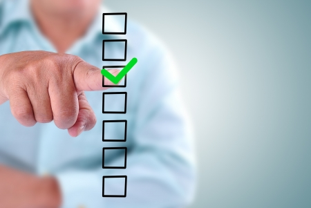 choose person: business man designed on a checklist box. With green checklist