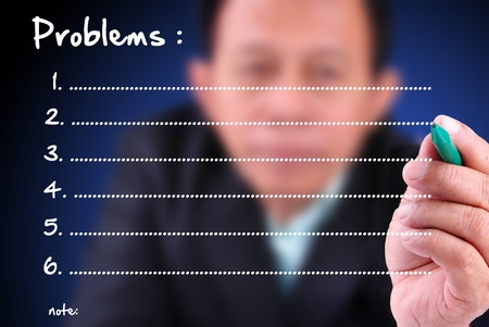 collate: business man writing problem list with note