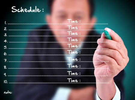 business man writing schedule with time photo