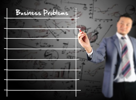 collate: Business man writing business problems