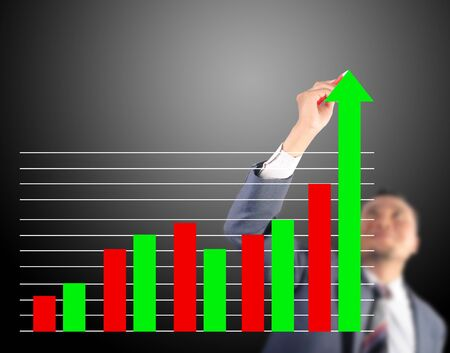 Business man touching growth graph photo