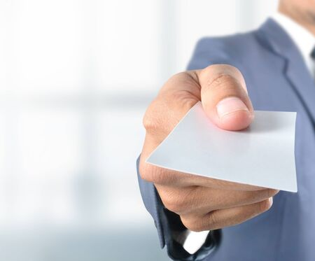 business card in hand: Business man show blank card