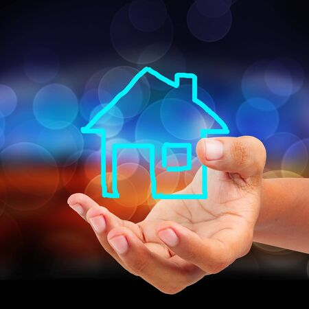 Hand holding house sketch Stock Photo - 17264311