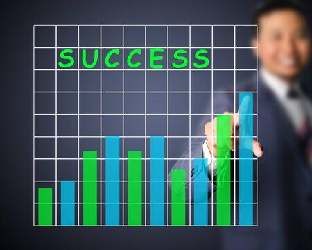 Business man designed graph of success photo