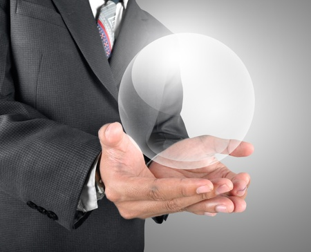 Business man holding crystal ball template photo