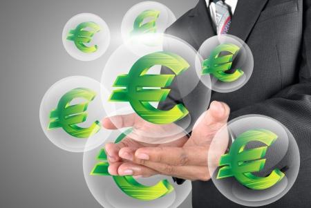 bonus: business man holding euro icon