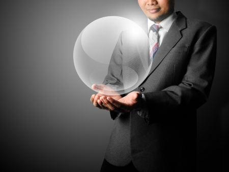 bright future: Business man holding crystal ball template