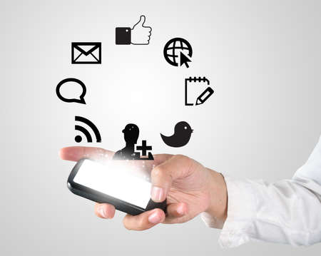 Business hand touching digital screen of mobile phone  Stock Photo - 18592671