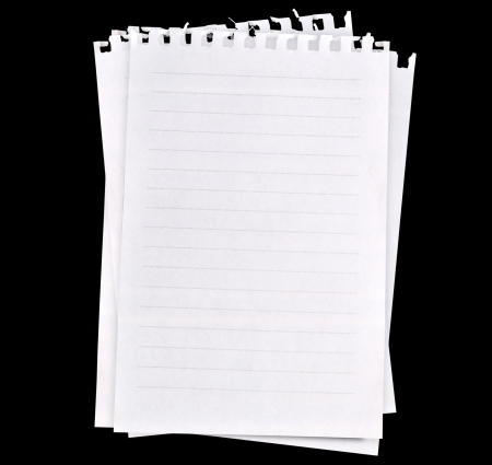Blank papers isolated on black background photo