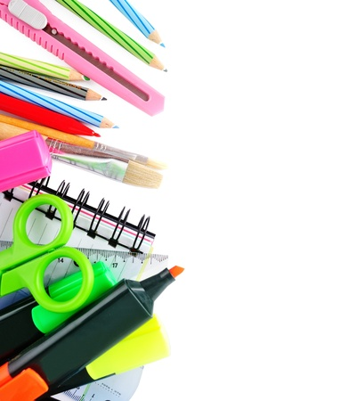 secondary education: School stationery isolated over white for layout design and copy space