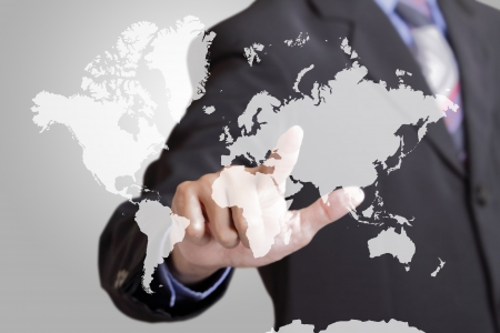 Business man touching strategy of business world wide  Stock Photo