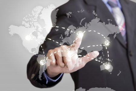 world wide: Business man touching strategy of business world wide  Stock Photo