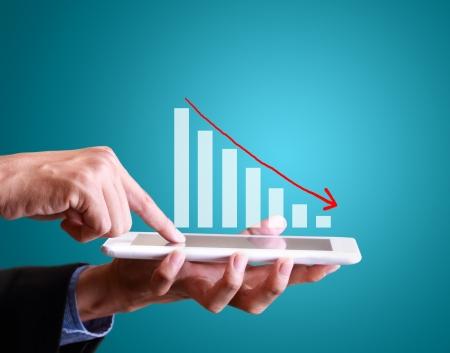 contabilidad: hombre de negocios con s�mbolos financieros procedentes de los medios digitales