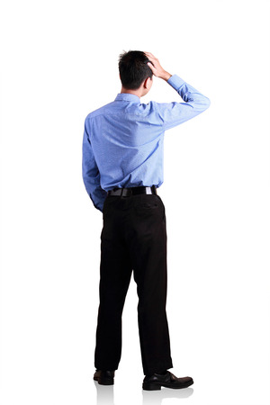 Attractive businessman standing over white  photo