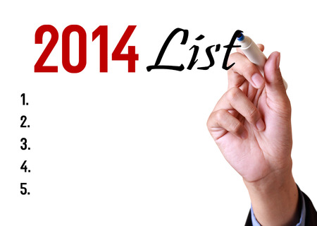 business man writing 2014 list photo