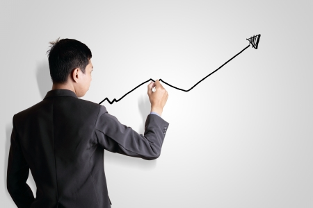 Business man drawing growth graph photo