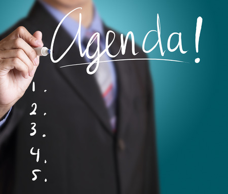 Businessman writing agenda Stock Photo