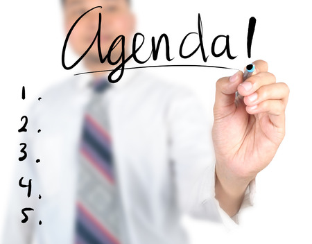 Businessman writing agenda photo