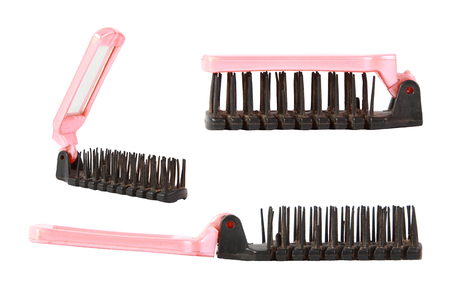 long handled: comb on white background