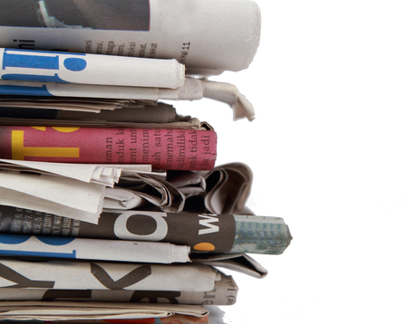 magazine stack: newspaper on white