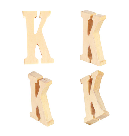 prinitng block: English alphabet  K - collage of 4 isolated vintage wood Stock Photo