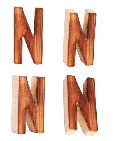 prinitng block: English alphabet  N - collage of 4 isolated vintage wood