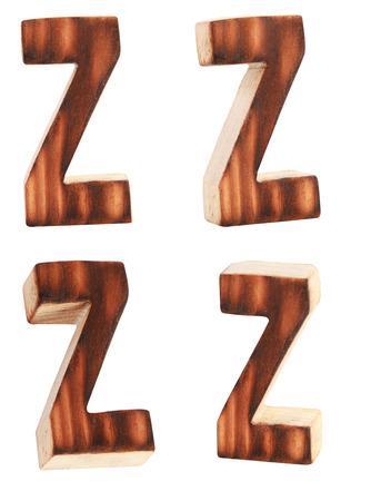 prinitng block: English alphabet  Z - collage of 4 isolated vintage wood