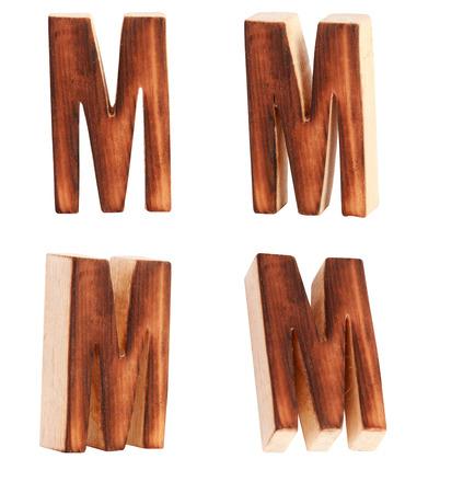 prinitng block: English alphabet  M - collage of 4 isolated vintage wood