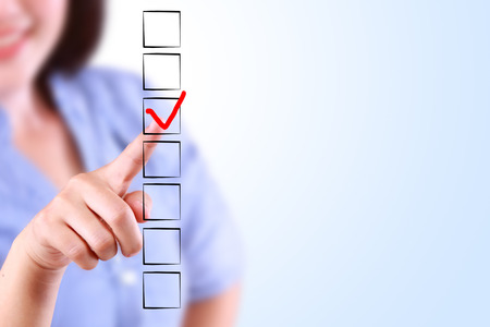 checklist: Beautiful business woman marking Check list