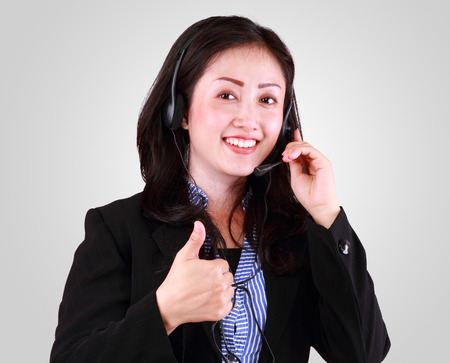 Attractive business woman smiling with headset  photo