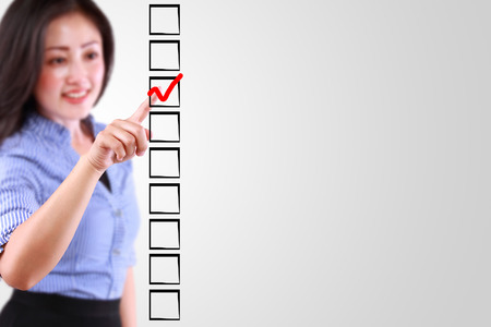 business woman designed on a checklist box photo