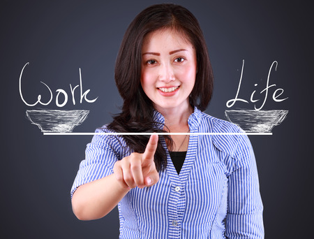 business woman showing balncing concept work and life photo