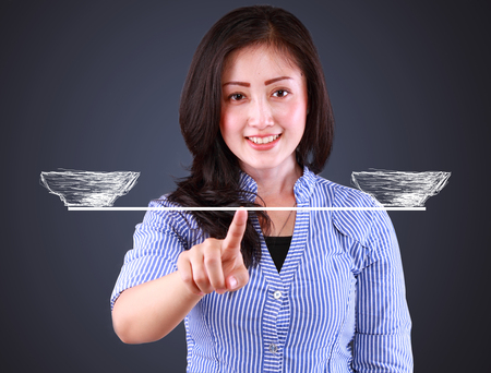 equivalent: business woman showing balancing concept Stock Photo