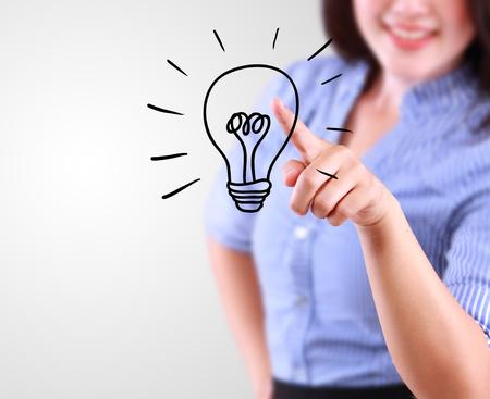 designate: business woman designate a lamp of idea