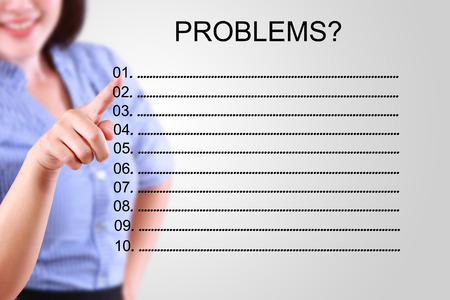 collate: business woman pointing problem list