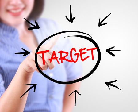 compile: Business woman touching business target Stock Photo