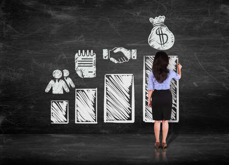 business woman drawing step of profit on white wall photo