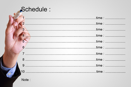 school schedule: businessman writing schedule with time