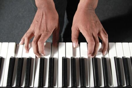 playing piano: Hands playing piano