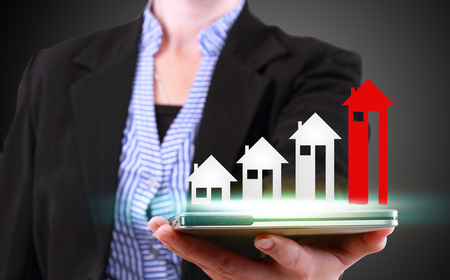 commercial sign: businesswoman showing property concept Stock Photo